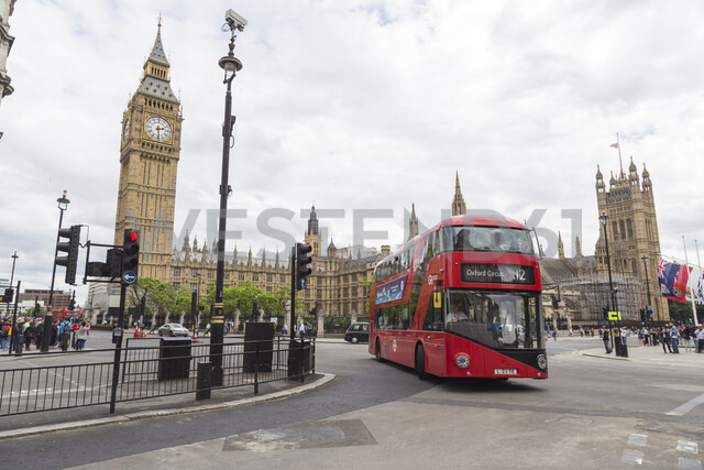 Double Decker bus by Big Ben in London, England - FOLF10250