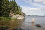 Girl wading in the sea in Mjorn, Sweden - FOLF10259