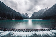 Landscape with lake weir and snow capped mountains, Dolomites, Italy - ISF20203