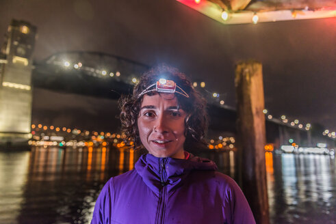 Runner with headlamp in urban North Vancouver, Canada - ISF20212