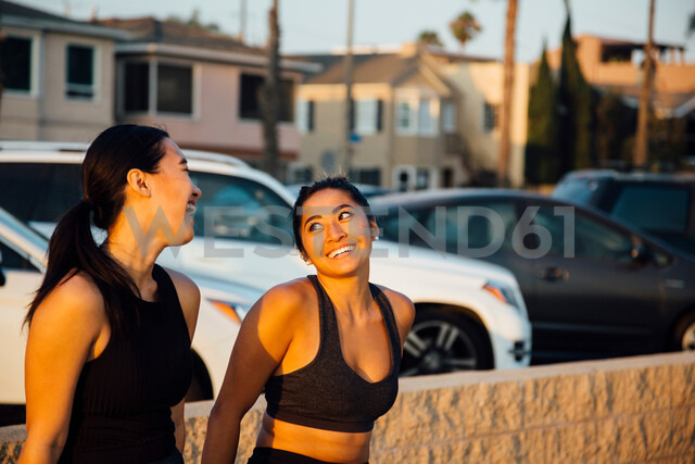 Friends talking by beach, Long Beach, California, US - ISF20221
