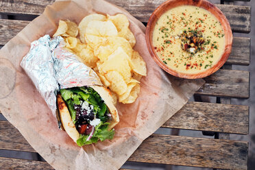 Meal of salad wrap, potato chips and dip - ISF20281