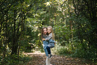 Sisters hugging in forest - ISF20308