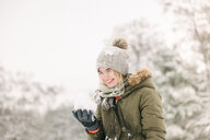 Girl with snow ball in winter landscape - ISF20329
