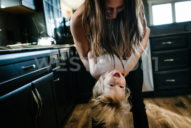 Mother and son playing in kitchen - ISF20389