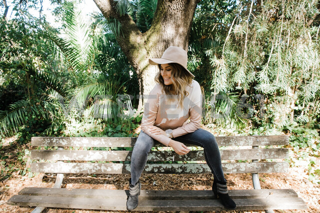 Woman relaxing on park bench, San Rafael, California, US - ISF20404