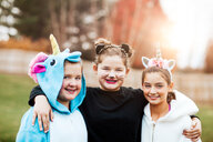 Girls in halloween costume posing in park - ISF20470