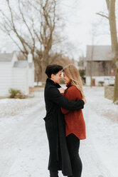 Couple hugging in snowy landscape, Georgetown, Canada - ISF20485