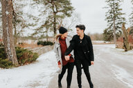 Couple walking in snowy landscape, Georgetown, Canada - ISF20488