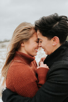Couple hugging in snowy landscape, Georgetown, Canada - ISF20491