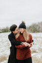 Couple hugging in snowy landscape, Georgetown, Canada - ISF20494