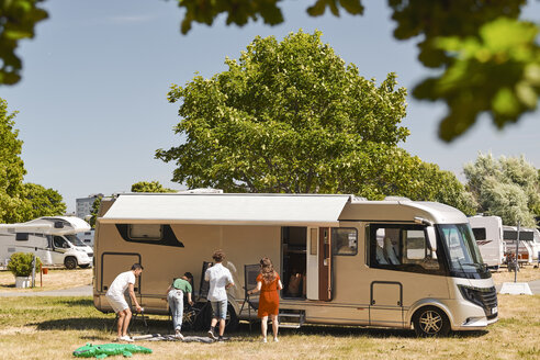 Family against motor home camping at trailer park during summer vacation - MASF11029