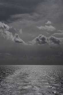 Black and white storm clouds over ocean - FSIF03704