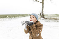 Boy playing with snow in winter - KMKF00705