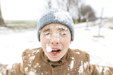 Portrait of boy with snow in his face - KMKF00708