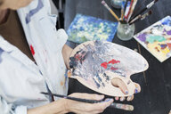 Midsection of senior woman using palette and paintbrush - ASTF02317