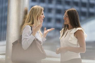 Two women talking in the city - SBOF01620