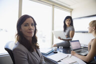 Portrait confident businesswoman in conference room meeting - HEROF05670