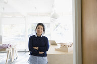 Portrait confident female architect with arms crossed in office - HEROF05856