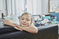 Portrait of confident girl on couch at home - RORF01589