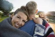 Portrait young woman hugging boyfriend on summer beach - HEROF05918
