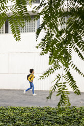 Running woman with backpack in the city - MAUF02338
