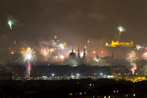 Germany, Wuerzburg, fireworks over cityscape at New Year's Eve - NDF00857