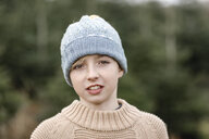 Portrait of a boy wearing woolen hat - KMKF00725