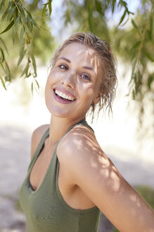 Portrait of a beautiful woman with wet hair, laughing - PNEF01154