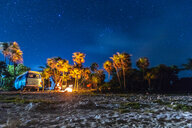 Mexico, Yucatan, Quintana Roo, Tulum, camper van on the beach at night with palm trees - MMAF00775