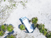 Mexico, Yucatan, Quintana Roo, Tulum, drone view of camper van on the beach with palm trees - MMAF00778