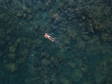 Woman snorkeling in ocean, Amed beach, Bali, Indonesia - KNTF02603