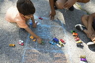 Boy playing with toy cars - HEROF06157