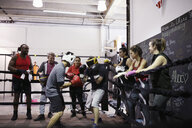 Boxers training in boxing ring in gym - HEROF06340