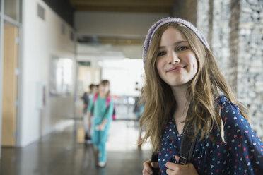 Portrait of confident school girl in corridor - HEROF06529