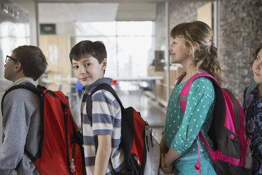 Portrait of confident school boy in corridor - HEROF06541