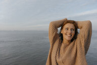 Germany, Hamburg, happy woman at the Elbe shore - JOSF02882
