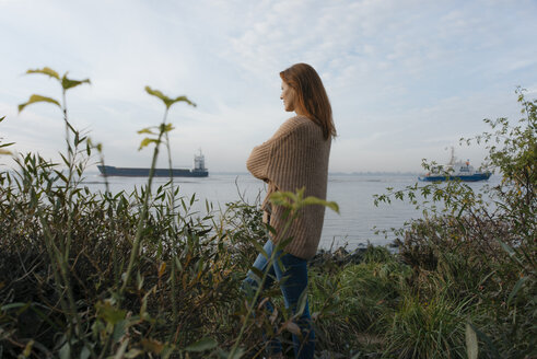 Germany, Hamburg, woman standing at the Elbe shore - JOSF02894