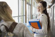 High school students talking in corridor - HEROF06583