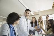 High school students and teacher conducting scientific experiment - HEROF06604