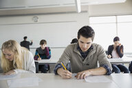 High school students taking test in classroom - HEROF06694