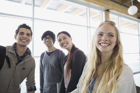 High school students smiling in corridor - HEROF06718