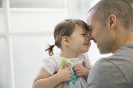 Father and daughter rubbing noses - HEROF06721