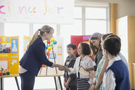 Elementary teacher handshaking with students at science fair - HEROF06763