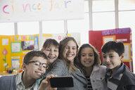 Elementary students taking selfie at science fair - HEROF06766