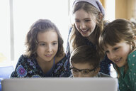 Elementary students using laptop in classroom - HEROF06787