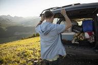 Man preparing for camping at back of SUV, Alberta, Canada - HEROF07045