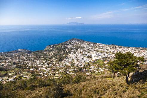 Italy, Campania, Gulf of Naples, Capri Island, aerial view of its buildings against Thyrrenian Sea - FLMF00098
