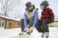 Father and son getting ready to skate - HEROF07458