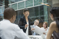 Businesswoman leading meeting in conference room - HEROF07518